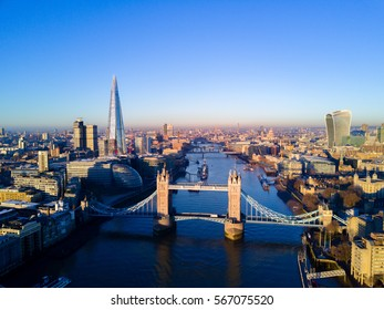Aerial view over Tower Bridge, River Thames and the city of London, UK