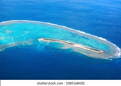 Aerial view over the tropical resort island of Nagannu in Okinawa, Japan surrounded by beautiful turqoise water