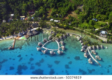 Aerial View of over water bungalows at Bora Bora.