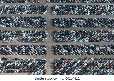Aerial view of packed used automobile storage lot.