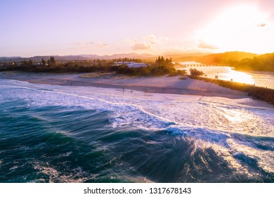 Aerial view of Palm Beach suburb coastline at sunset. People on the beach. Gold Coast, Queensland, Australia