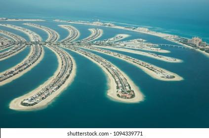 Aerial view of Palm Jumeirah man made island on a sunny day. Dubai, UAE.