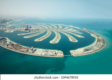 Aerial view of Palm Jumeirah man made island and Dubai Marina and JBR district on a sunny day. Dubai, UAE.