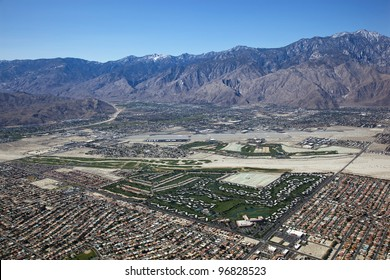 Aerial  view of Palm Springs, California with the snow dusted San Jacinto Mountains as a backdrop