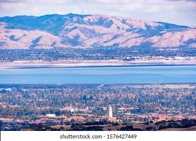 Aerial view of Palo Alto, San Francisco Bay Area; Newark and Fremont and the Diablo mountain range visible on the other side of the bay; Silicon Valley, California