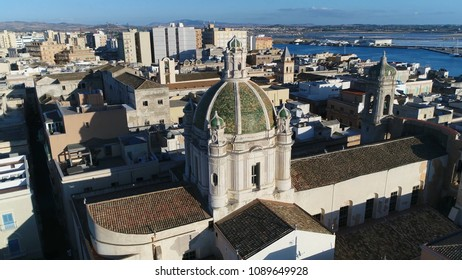 Aerial view panning around Trapani Cathedral dome or Basilica of St. Lawrence the Martyr is cathedral of Roman Catholic Diocese of Trapani dedicated to Saint Lawrence in Trapani Sicily Italy 4k