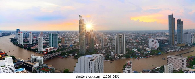 Aerial view Panorama Bangkok city metropolis skyline landscape and River twilight sunset in Asia Thailand