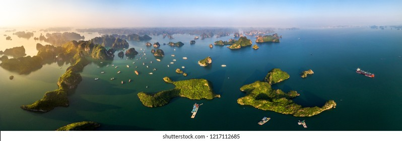 Aerial view panorama of floating fishing village and rock island, Halong Bay, Vietnam, Southeast Asia. UNESCO World Heritage Site. Junk boat cruise to Ha Long Bay. Popular landmark of Vietnam