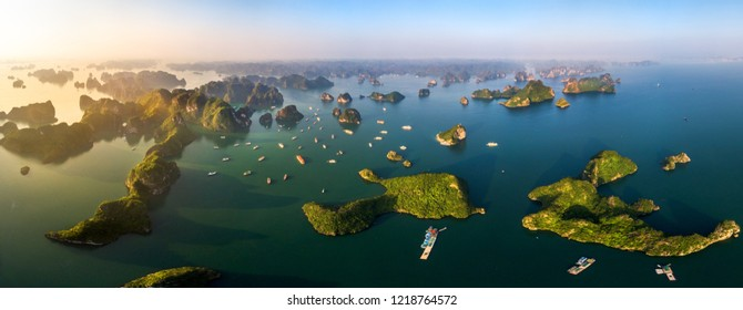 Aerial view panorama, floating fishing village and rock island, Halong Bay, Vietnam, Southeast Asia. UNESCO World Heritage Site. Junk boat cruise to Ha Long Bay. Popular landmark, famous destination