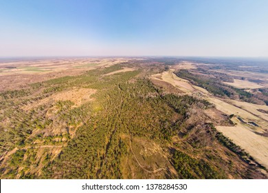 Aerial view panorama of a landscape with fields and forests in Latvia