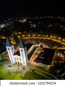 Aerial view, panorama of the Saint James Church at night, during mass (Crkva Svetog Jakova) in Medjugorje, Bosnia and Herzegovina