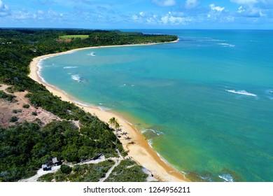 Aerial view of a paradise sea with clear water. Fantastic landscape. Great beach view. Espelho's Beach, Trancoso, Porto Seguro, Bahia, Brazil. Paradise beach. Beautiful cliffs. Tropical travel.