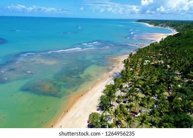 Aerial view of a paradise sea with clear water. Fantastic landscape. Great beach view. Espelho's Beach, Trancoso, Bahia, Brazil. Vacation travel. Travel destination. Paradisiac beach.
