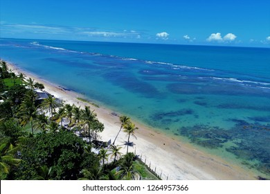 Aerial view of a paradise sea with clear water. Fantastic landscape. Great beach view. Arraia d'Ajuda, Bahia, Brazil
