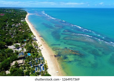 Aerial view of a paradise sea with clear water. Fantastic landscape. Great beach view. Arraia d'Ajuda, Bahia, Brazil. Travel, vacation, destination, tourism point, tranquility, dream, peace.