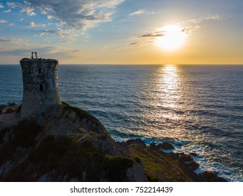 Aerial view of the Parata Tower from the sea, Genoese tower built in 1608, Corsica. France. Sunset over the sea in the Gulf of Ajaccio near the bloody islands