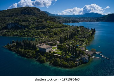 Aerial view of Parco Baia delle Sirene, Lake Garda, Italy. Panorama of punta san vigilio. Baia delle Sirene on the coastline. Top view of baia delle sirene on the coastline of Lake Garda.