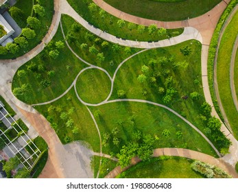 Aerial view of Parco del Portello in Milan, near CityLife, Lombardia. View from the height of park with a green lawn and paths. Abstract design similar to a dragon. Drone photography in Milano.