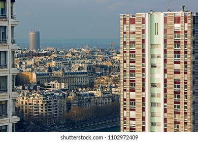 Aerial view of Paris with apartment block in foreground