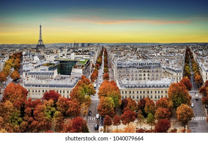 Aerial view of Paris in late autumn at sunset.Red and orange colored street trees. Eiffel Tower in the background. Paris, France.