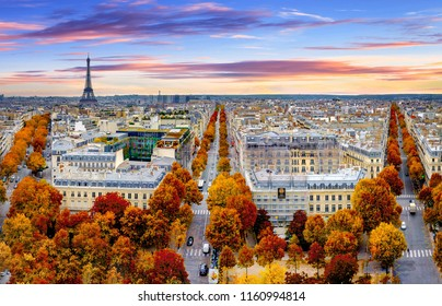 Aerial view of Paris in late autumn at sunset.Red and orange colored street trees. Eiffel Tower in the background. Paris, France