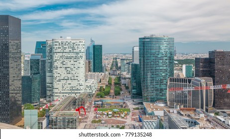 Aerial view of Paris and modern towers timelapse from the top of the skyscrapers in Paris business district La Defense. Sunny summer day with blue cloudy sky. Paris, France