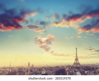 Aerial View of Paris skyline and Eiffel tower with cloud in form of heart, France. Business, Love and travel concept