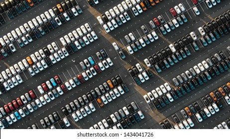 Aerial view of the parked new cars at the automotive plant