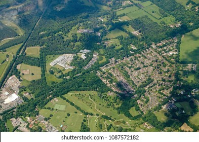 Aerial view of part of the Surrey village of Windlesham.  Together with housing and a golf course, the research and development site of the pharmaceutical company Eli Lilly is visible in the centre