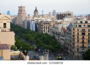 Aerial view of Passeig de Gracia major avenues in Barcelona in summer day, Spain
