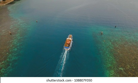 Aerial view passenger ferry floats in the blue sea.Asian passenger boat floating in the ocean.Philippines, Camiguin. Passenger ferry boat Camiguin to Mindanao. Travel concept.