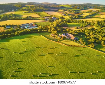 Aerial view of pastures and farmlands in Brittany, France. Beautiful French countryside with green fields and meadows. Rural landscape on sunset - Shutterstock ID 1800774577