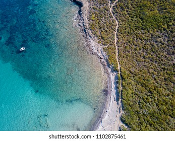 Aerial view of the path of customs officers, vegetation and Mediterranean bush, Corsica, France. Sea and vegetation seen from above, rocks and rocks. Sentier du Douanier. Capo Corso