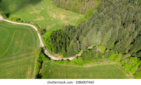 aerial view of a path in the Jura between field and forest