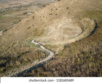 Aerial view of path and ruins (theatre) located in Finiq Archaeological park, Albania