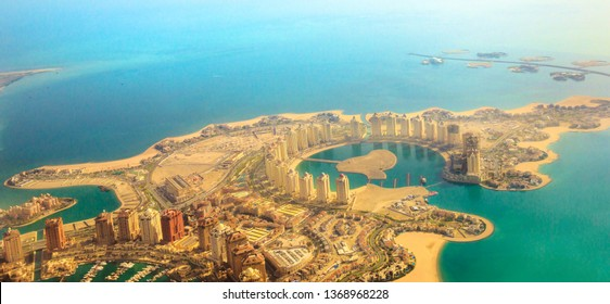 Aerial view of the Pearl-Qatar, the artificial island in Persian Gulf, Doha, Qatar, Middle East. Scenic flight of Viva Bahriya in Maghreb and Moorish style and exclusive Dana Island. Banner panorama.