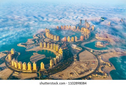 Aerial view of the Pearl-Qatar island in Doha through the morning fog. Qatar, the Persian Gulf