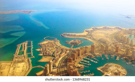 Aerial view of the Pearl-Qatar, the luxurious and modern artificial island in Persian Gulf, Doha, Qatar, Middle East. Venice at Qanat Quartier, Marsa Malaz Kempinski hotel and towers of Porto Arabia.