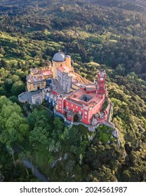 Aerial view of Pena Palace, a colorful Romanticist castle building on hilltop during a beautiful sunset, Sintra, Lisbon, Portugal