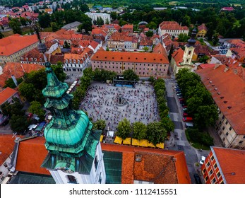 Aerial view of people dancing in the town square in front of the church, celebrating birthday of town Karlovac taken from the sky, Dan grada Karlovca