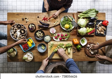Aerial view of people with fresh organic vegetable preparing to cook