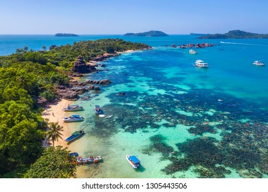Aerial view of people swimming on the sea and beach on Gam Ghi Phu Quoc island in Thailand bay, Kien Giang, Vietnam.