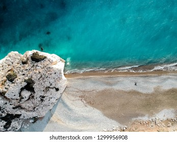 Aerial view of Petra tou Romiou, aka Aphrodite's rock a famous tourist travel destination landmark in Paphos, Cyprus. The sea bay of goddess Afroditi birthplace from above.