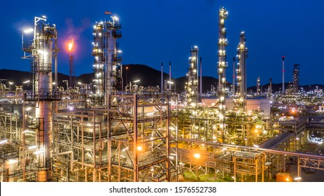 Aerial view petrochemical plant and oil refinery plant background at night,  Petrochemical oil refinery factory plant at night.