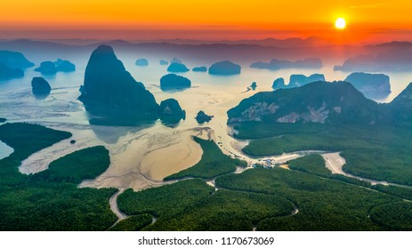 Aerial view  Phang Nga bay at sunrise with mangrove tree forest and hills in the Andaman sea, Thailand.