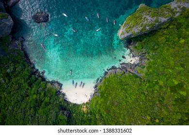 aerial view phi phi island high season thai and foreign tourists are snorkelling by renting a long tail boat and speed boat for travelling on phi phi island kra bi Thailand
