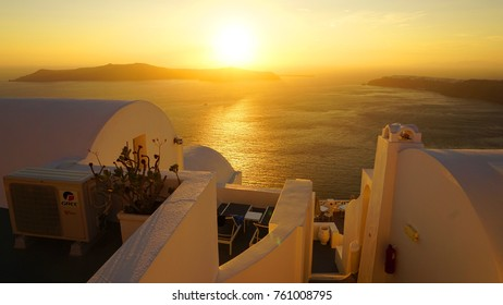 Aerial view photo of volcanic island of Santorini, Imerovigli village with view to the caldera at sunset, Cyclades, Aegean, Greece