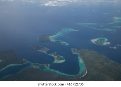 Aerial view photograph of small islands in the Solomon Islands.