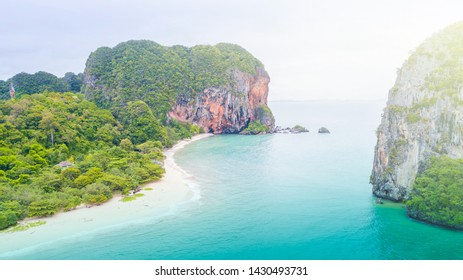 Aerial view of Phranag Beach, Railay Bay in Krabi Thailand with the spectacular mountain and white beach along the emerald water.