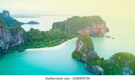 Aerial view of Phranag Beach, Railay Bay in Krabi Thailand with the spectacular mountain and white beach along the emerald water and island.